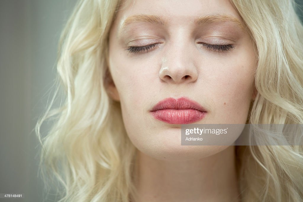 Young woman with eyes closed : Stock Photo