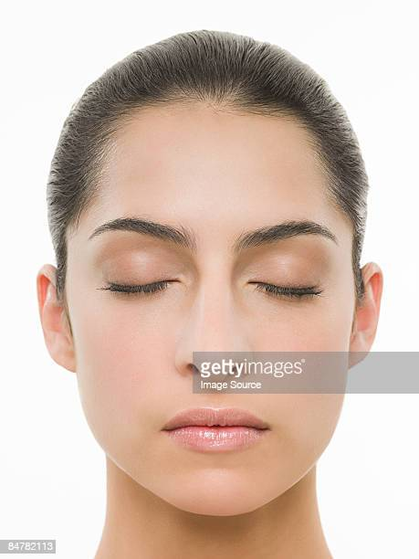 young woman with eyes closed - ponytail stock pictures, royalty-free photos & images