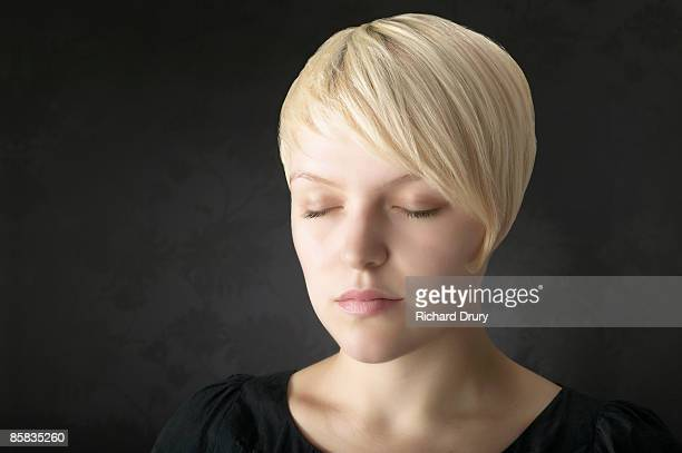 young woman with eyes closed - richard drury stock pictures, royalty-free photos & images