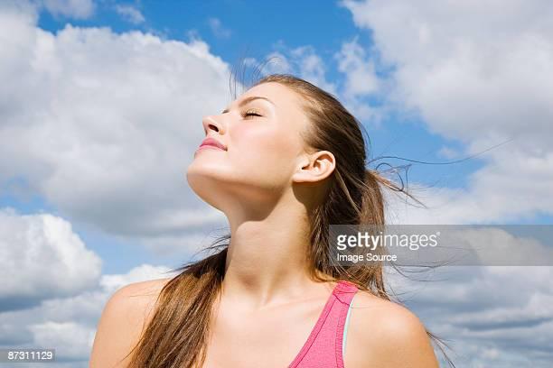 young woman with eyes closed - women sunbathing fotografías e imágenes de stock