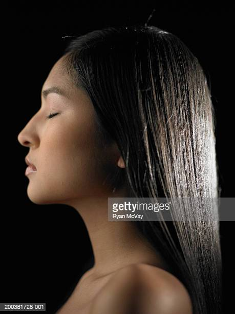 Young woman with eyes closed, profile
