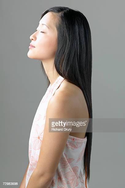 young woman with eyes closed, side view - richard drury stock pictures, royalty-free photos & images