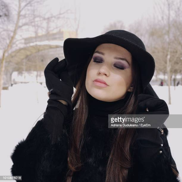 Young Woman With Eyes Closed Standing At Park During Winter