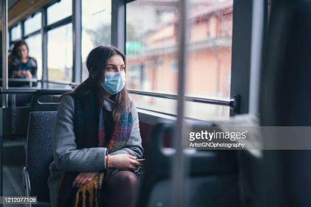 young woman with face mask talking on the phone. - science and technology stock pictures, royalty-free photos & images