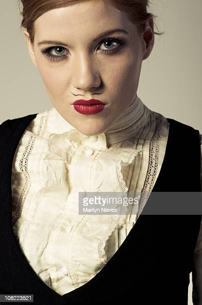 young woman with fake painted mustache - neck ruff stock pictures, royalty-free photos & images