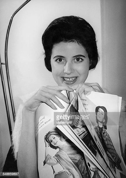 young woman with fashion magazine 1950s