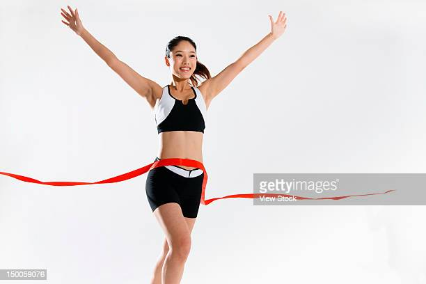 young woman with finish line - ゴールライン ストックフォトと画像