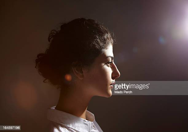 young woman with flare behind her