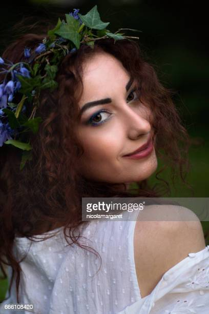 Young woman with floral headdress