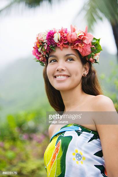 young woman with flowers in hair in moorea - polynesian culture stock photos and pictures