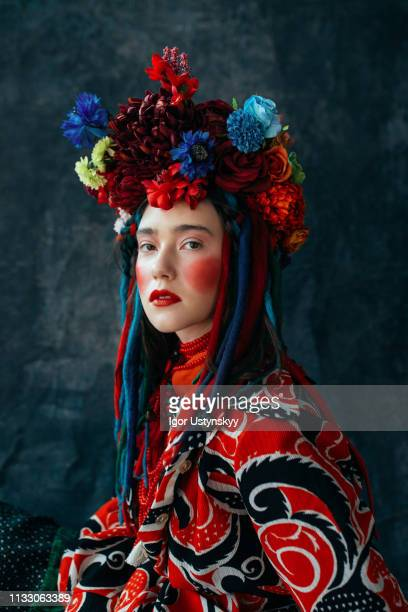 young woman with flowers in her hair - headdress stock pictures, royalty-free photos & images