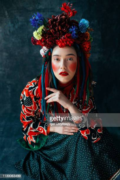 young woman with flowers in her hair - blank expression stock pictures, royalty-free photos & images