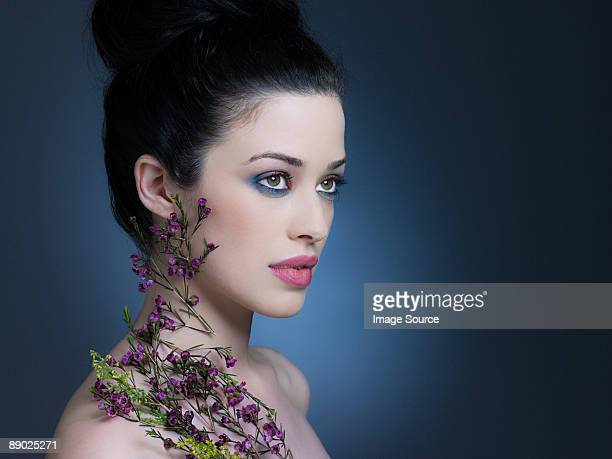 young woman with flowers - アイメイク ストックフォトと画像