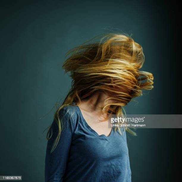 young woman with flying blonde hair - crazy hair stock pictures, royalty-free photos & images