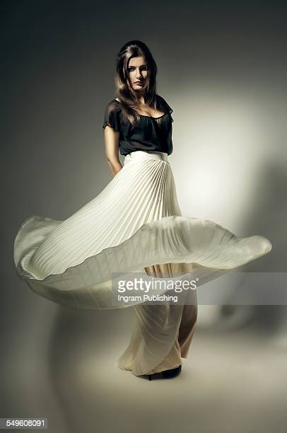 Young woman with flying maxi skirt