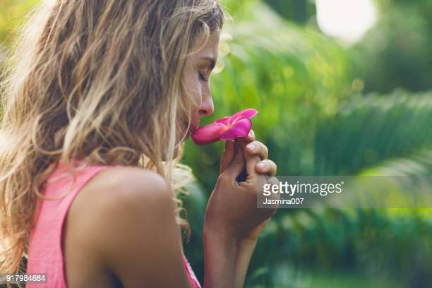 Young woman with frangipani flower