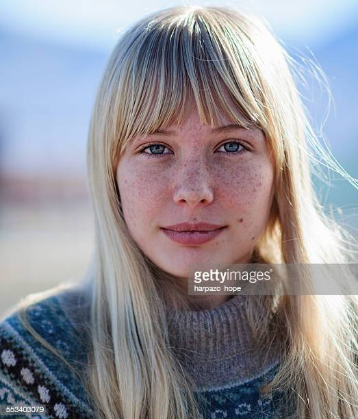 Young woman with freckles.