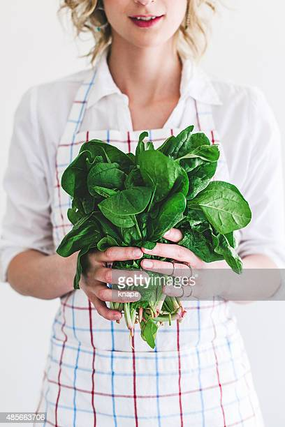 Young woman with fresh spinach
