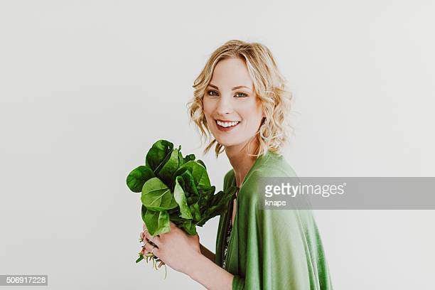 young woman with fresh spinach - spinach stock photos and pictures