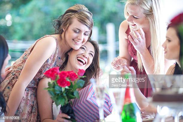 Young woman with friends and birthday presents