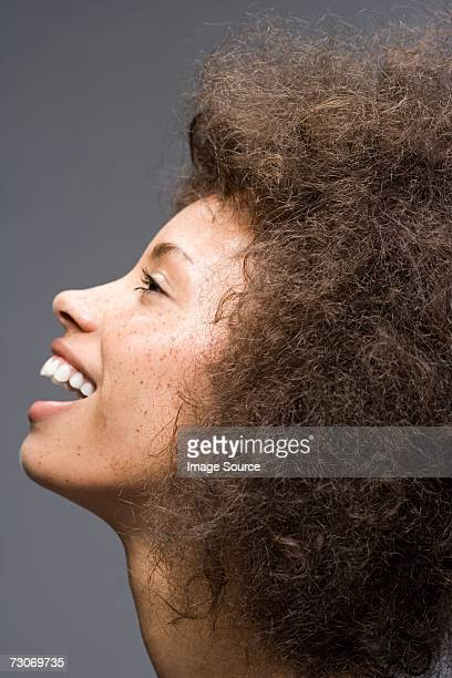 young woman with frizzy hair - afro stock pictures, royalty-free photos & images