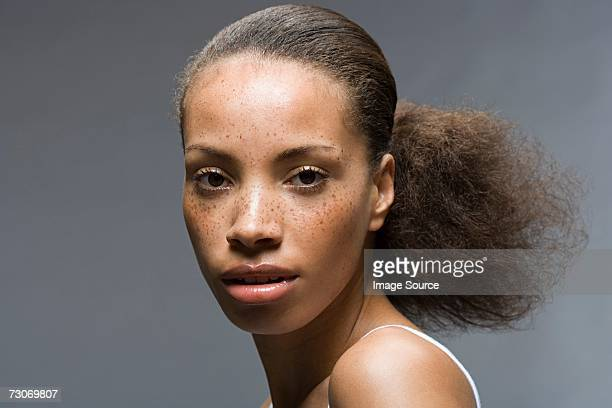 Young woman with frizzy ponytail