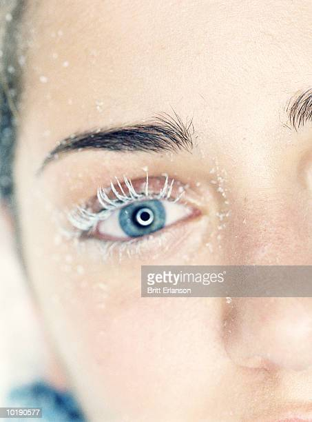 Young woman with frosted eyelashes, close-up