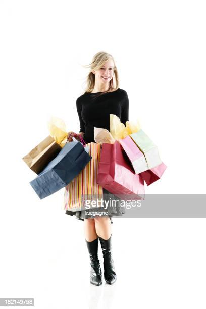 Young woman with full of bags