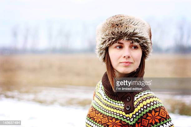 Young woman with fur hat