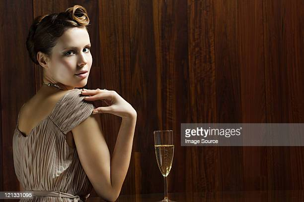 Young woman with glass of champagne, portrait