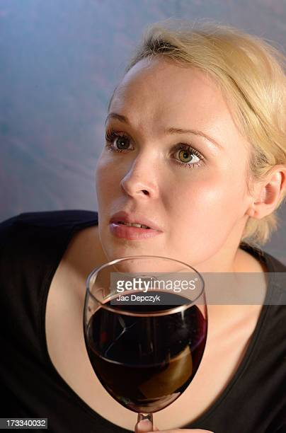 young woman with glass of wine - depczyk stock pictures, royalty-free photos & images