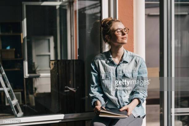 young woman with glasses in sunlight - mindfulness stock pictures, royalty-free photos & images