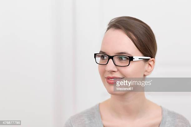 Young woman with glasses thinking