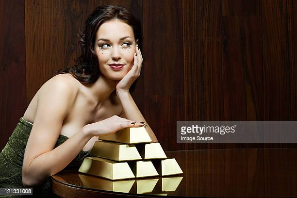 young woman with gold ingots - millionnaire stock photos and pictures