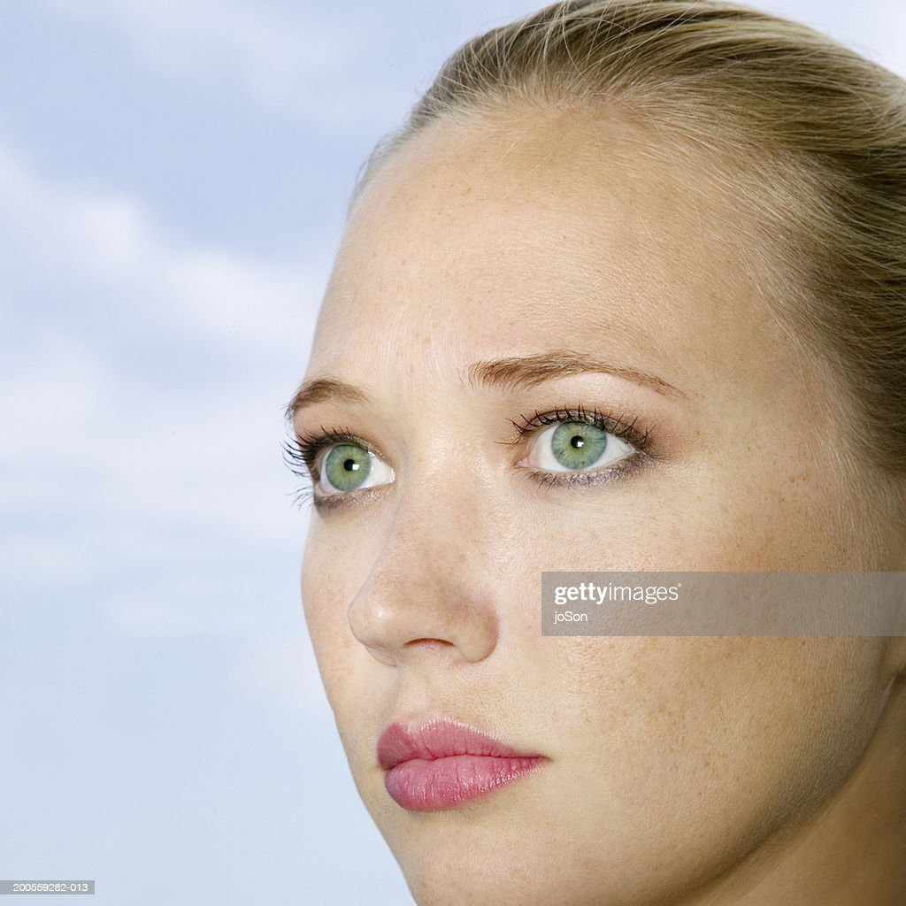 Young Woman With Green Eyes Closeup Stock Photo