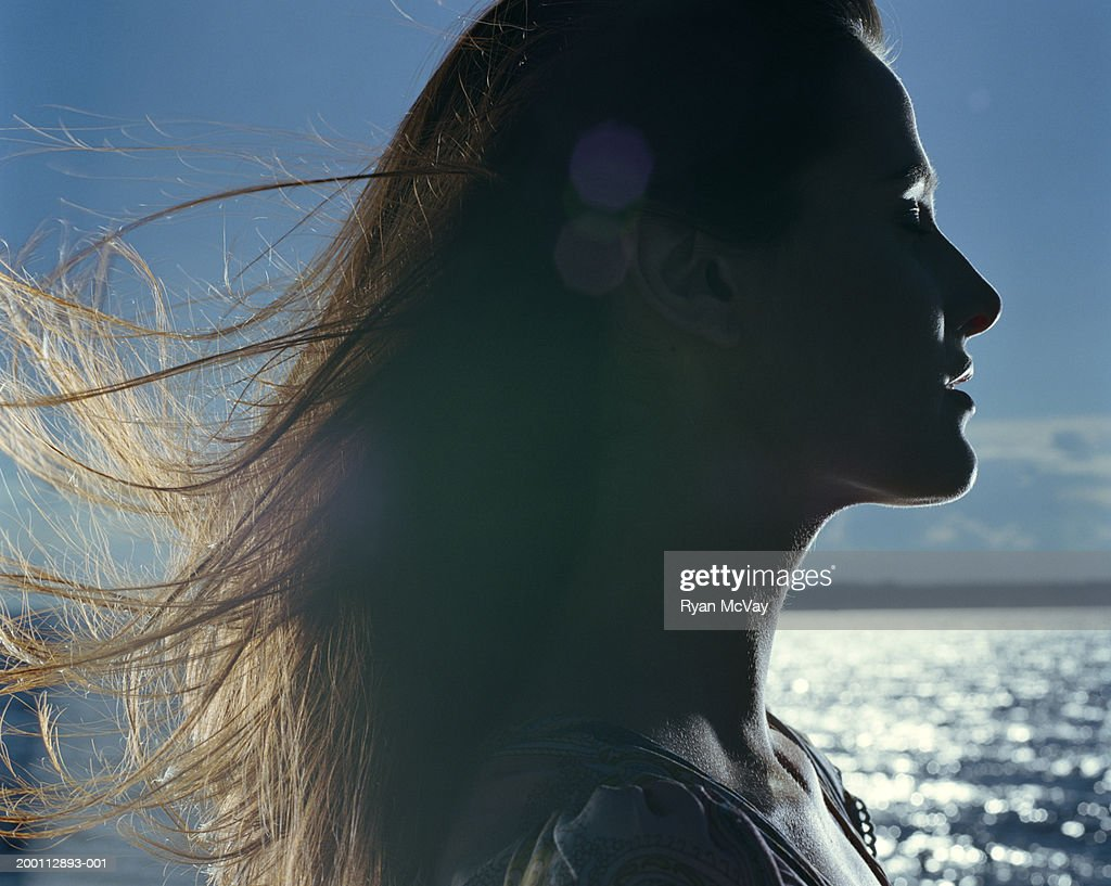 Young woman with hair blowing in wind, profile : Foto stock