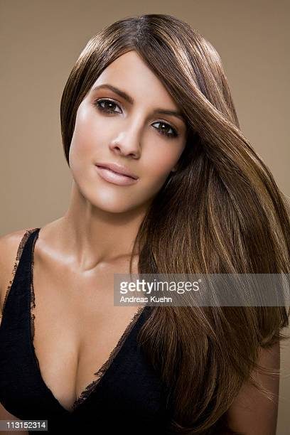 young woman with hair blowing, portrait. - dominican ethnicity stock photos and pictures