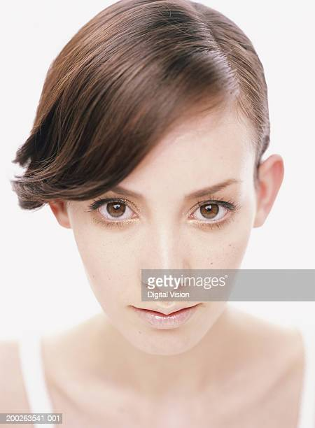 young woman with hair brushed at side parting, close-up, portrait - 髪の分け目 ストックフォトと画像