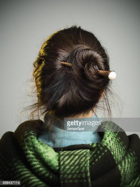 Young woman with hair bun.