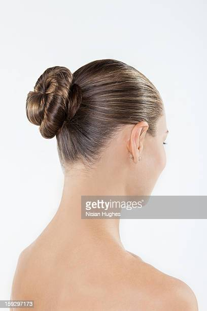 Young woman with hair in bun, rear view