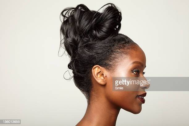 Young woman with hair tied up, side view