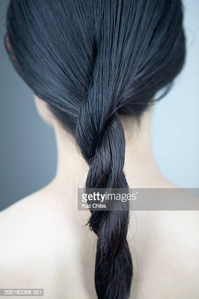 Young woman with hair twisted, rear view