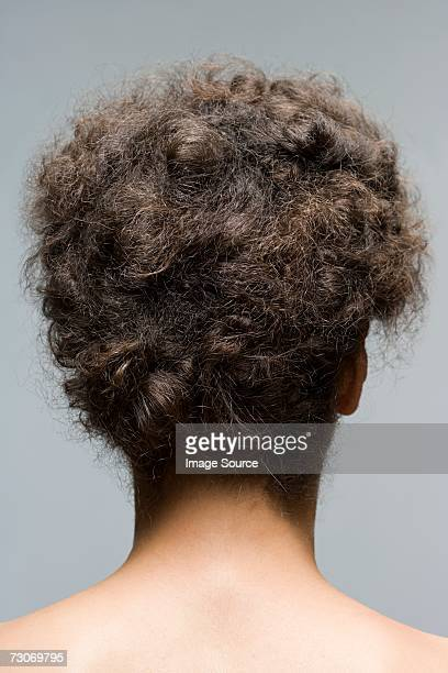 young woman with hair up - frizzy stock pictures, royalty-free photos & images