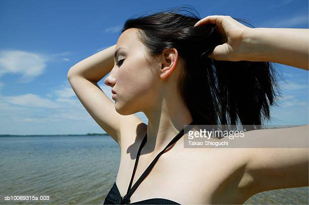 young woman with hand in hair, eyes closed - contea di prince edward ontario foto e immagini stock