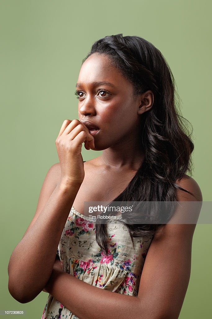 Young woman with hand on her mouth. : Stock Photo