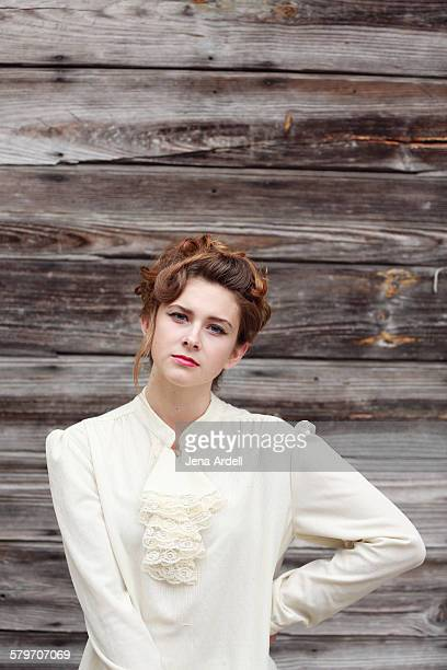 young woman with hand on hip - blouse stockfoto's en -beelden