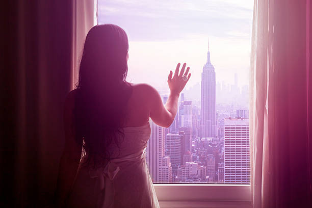 Young Woman With Hand On Window And New York Skyline Wall Art