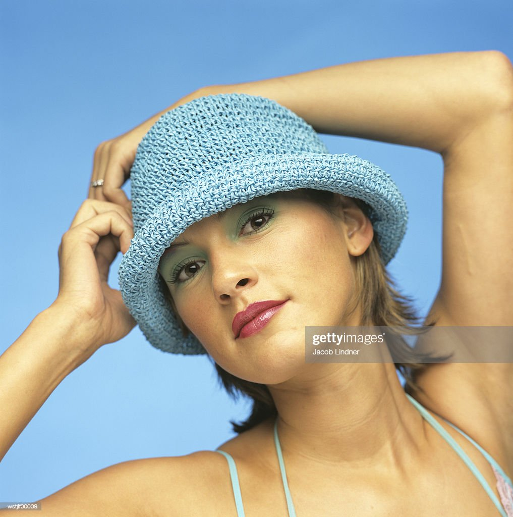 Young woman with hands behind head : Stock Photo