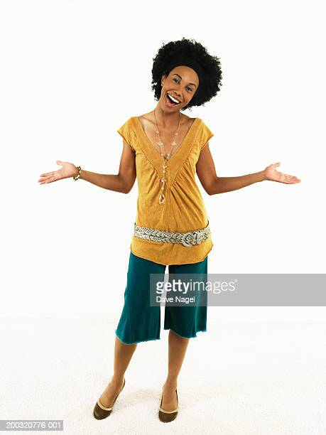 young woman with hands extended outward, portrait - culottes stock pictures, royalty-free photos & images
