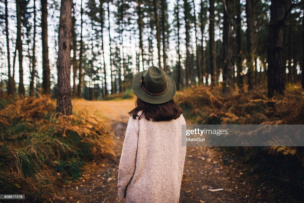 Young woman with hat at forest : Stock Photo